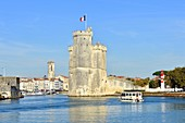 France, Charente-Maritime, La Rochelle, Saint Nicolas tower(tour Saint-Nicolas) at the entrance to the Old Port and the St Sauveur church at the back