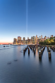 View across the water of New York City,Manhattan island,at dawn,flat calm water.