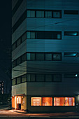 Night scene of an apartment building with the ground floor lit up,Osaka,Japan
