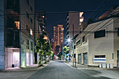 Night scene of downtown apartment blocks,retail buildings and modern office buildings in distance,Osaka,Japan