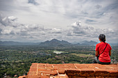 Woman enjoying view on top of ancient fortress,Sigiriya,Sri Lanka