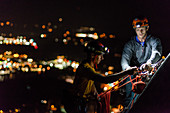 Two men trad climbing at night,Squamish,British Columbia,Canada