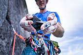 Climber taping bleeding finger,trad climbing,Stawamus Chief,Squamish,British Columbia,Canada