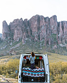 Woman in off road vehicle,Superstition mountains in background,Arizona,United States