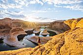 Backpacker at sunrise,Reflection Canyon,Lake Powell,Utah,US