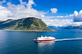 Aerial view by drone of Hurtigruten during a daily trip along the fjord, Alesund, More og Romsdal county, Norway, Scandinavia, Europe