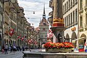 Tourists along Marktgasse, shopping street in the Old Town (Altstadt) with Kafigturm tower in background, Bern, Switzerland, Europe