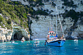 Tourist boats at the Blue Caves, Paxos, Ionian Islands, Greek Islands, Greece, Europe