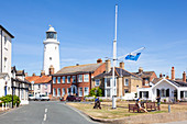 Southwold Lighthouse and houses, with people on a bench, St. James Green, East Cliff, Southwold, Suffolk, England, United Kingdom, Europe