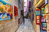 View of fine art and colourful paintings on cobbled street in the old town, Rovinj, Istria, Croatia, Adriatic, Europe