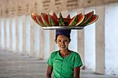 Burmese lady selling water melons. Nyaung U, Bagan (Pagan), Myanmar (Burma), Asia