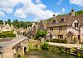 Water Lane with bridge over By Brook on to The Street, Castle Combe village, Castle Combe, Cotswolds, Wiltshire, England, United Kingdom, Europe