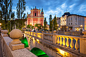 The pink Franciscan Church and the Triple Bridge (Tromostovje) at night, Ljubljana, Slovenia, Europe