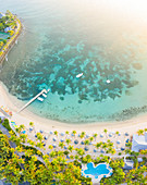 Panoramic of palm-fringed beach of luxury resort washed by Caribbean Sea from above, Morris Bay, Old Road, Antigua, Leeward Islands, West Indies, Caribbean, Central America