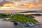 Sunset over the traditional houses of fishermen on islets along the Atlantic Road, More og Romsdal county, Norway, Scandinavia, Europe