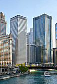 Downtown skyline and river cruise boat on the Chicago River near the Michigan Avenue Bridge, Chicago, Illinois, United States of America, North America
