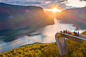 People admiring sunset from Stegastein viewpoint platform above the fjord, aerial view, Aurlandsfjord, Sogn og Fjordane county, Norway, Scandinavia, Europe