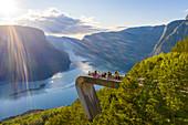 Tourists admiring the fjord from Stegastein viewpoint, Aurlandsvangen, Sognefjord, Norway, Scandinavia, Europe