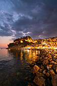 Sunset at Parga Castle and harbour, Parga, Preveza, Greece, Europe