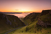 A photographer at Winnats Pass at sunrise, Hope Valley, Edale, Peak District, Derbyshire, England, United Kingdom, Europe