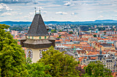 View of Clock Tower and cityscape, Graz, Styria, Austria, Europe
