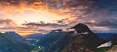 Fiery sky at sunset over Romsdalen and Venjesdalen mountains seen from Romsdalseggen Ridge, Andalsnes, More og Romsdal, Norway, Scandinavia, Europe