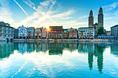 Limmatquai and Grossmunster Cathedral mirrored in Limmat River at dawn, Zurich, Switzerland, Europe
