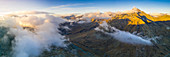 Aerial panoramic of sea of clouds over Pizzo Tambo and bends of the Spluga Pass road, Valle Spluga, Valtellina, Lombardy, Italy, Europe