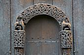 Carving on the north portal of Lom Stave Church, Stavkyrkje Lom, Lom, Oppland, Norway, Europe