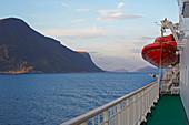 Hurtigruten and fjord landscape near Alesund, Möre og Romsdal province, Vestlandet, Norway, Europe