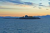 Munkholmen Fortress in front of Trondheim at sunrise, Trondheimsfjorden, Trondheim, Sör-Trondelag Province, Trondelag, Norway, Europe