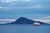 Hurtigruten ship Richard With in front of the island Bolga in the Rödöyfjorden, Rödöyfjord, Roedoeyfjorden, Roedoeyfjord, Helgeland coasts, Nordland province, Salten, Norway, Europe