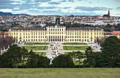 Elevated view of Schonbrunn Palace, UNESCO World Heritage Site, and Vienna city skyline viewed from Schonbrunn Palace garden, Vienna, Austria, Europe