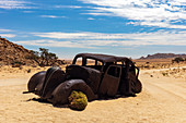 An Abandoned car that was shot down in a Diamond Heist in 1934 within Aus Vista, Namibia, Africa