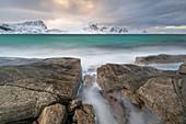 A long exposure at Haukland Beach with moody sky, Lofoten, Nordland, Arctic, Norway, Europe