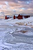 Fresh snow surrounds typical fishermen houses called Rorbu in winter, Eggum, Lofoten Islands, Arctic, Norway, Europe