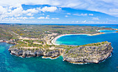 Aerial panoramic by drone of cliffs surrounding Half Moon Bay washed by Caribbean Sea, Antigua, Leeward Islands, West Indies, Caribbean, Central America