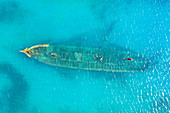 Aerial view by drone of a shipwreck in the shallow water of blue Caribbean Sea, Antilles, West Indies, Caribbean, Central America
