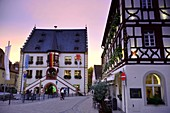 at the market square with parish church in Volkach am Main, Lower Franconia, Bavaria, Germany