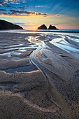 Sunset captured in March from the beach at Holywell Bay on the North Coast of Cornwall.  The image was carefully composed to make the most of the pool's of water on the beach.