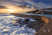 The pier at Porthleven on Cornwall's Lizard Peninsular, captured in February when sunset coincided with one of  the highest tides of the year.