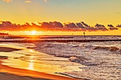 Sunset at the beach of the Baltic Sea in Kolobrzeg, Western Pomerania, Poland, Europe