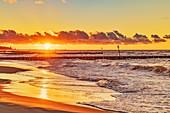 Sunset at the beach of the Baltic Sea in Kolobrzeg, Western Pomerania, Poland, Europe