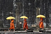 Buddhist monks at Bayon temple,Angkor Thom,Siem Reap,Cambodia,South east Asia.