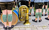 bavarian marching band dressed in traditional garment on the occasion of the_ partenkirchner festwoche_ during the traditional parade, garmisch-partenkirchen, bavaria, germany