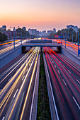 Traffic trail lights on major road near Beijing Zoo at dusk, Beijing, People's Republic of China, Asia