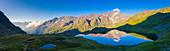 Aerial panoramic of Cima di Pietrarossa mirrored in Lago Nero at dawn, Gavia Pass, Valfurva, Valtellina, Lombardy, Italy, Europe
