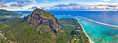 Majestic mountain overlooking the ocean and coral reef, aerial panoramic, Le Morne Brabant peninsula, Mauritius, Indian Ocean, Africa
