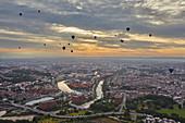 Hot-air balloons flying over the city of Bristol during the Bristol International Balloon Fiesta, Bristol, England, United Kingdom, Europe
