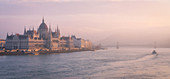 The Hungarian Parliament at sunset, Danube River, UNESCO World Heritage Site, Budapest, Hungary, Europe